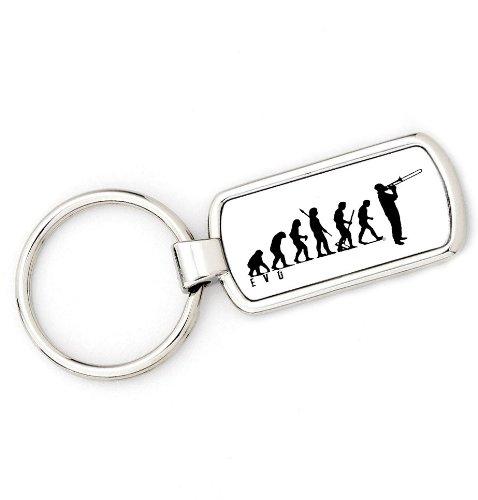 Schlüsselanhänger, Motiv vom Affen zum Menschen mit Posaune.