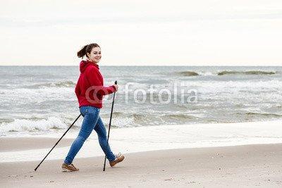 druck-shop24 Wunschmotiv: Nordic walking - young woman working out on beach #87717060 - Bild als Klebe-Folie - 3:2-60 x 40 cm/40 x 60 cm