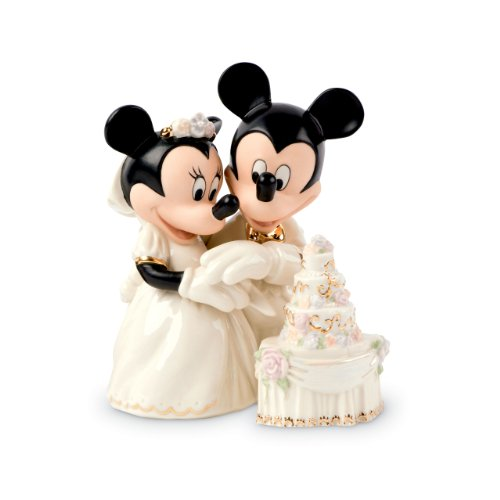 Minnies Dream Wedding Cake Figurine. Hand painted and accented with 24 karat gold. Made from fine china. Approximately 5.75 inches tall (15cm). Includes original manufacturers box and packaging. Made by Lenox. Officially licensed Disney Product. Oh, ...