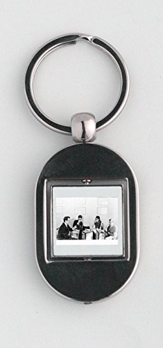 key-ring-with-yves-saint-laurent-drinking-champagne-with-people