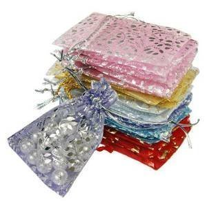Bold N Elegant Wedding Party Favor Gift Organizing Bags Jewellery Pouches Return Gift Candy Silver Coin Potli Pouch Bag Mix Colors 7 x 9 cm (Pack of 25 Pouches)  available at amazon for Rs.225