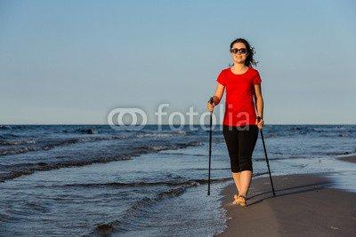 druck-shop24 Wunschmotiv: Nordic walking - young woman working out on beach #119458641 - Bild auf Leinwand - 3:2-60 x 40 cm/40 x 60 cm