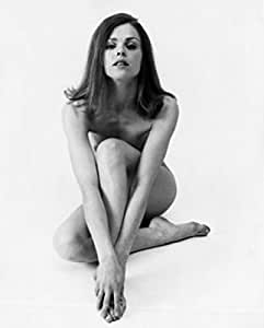 Naked young woman touching her feet Poster (45,72 x 60,96 cm)