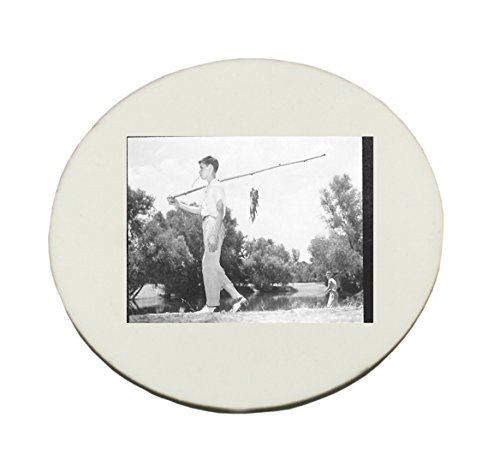 Circle Mousepad with A boy is having fish in his fishing rod.