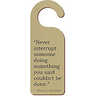 Stamp Press 'Never interrupt someone doing something you said couldn't be done.' Quote by Amelia Earhart 200mm x 72mm Door Hanger (DH00013922)