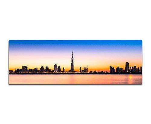 Panoramabild auf Leinwand und Keilrahmen 150x50cm Dubai Skyline Wolkenkratzer Wasser Abendlicht
