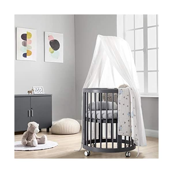 DUWEN Wooden Baby Cot European Multifunctional Small Round Bed Child Bed Convertible To 3 Positions Toddler Bed Sofa Bed Suitable For Cribs Under 6 Years (Color : Gray, Size : 123cm*68cm*76cm) DUWEN 【CONVERTIBLE CRIB】: Easy-to-change 3-in-1 cot can be easily converted from a crib to a nursing table and crib. The versatile crib will provide your child with a comfortable sleep. Beautifully designed cribs can grow with your child from infancy through childhood to adulthood. 【GROW UP WITH YOUR BABY】: The 3-bed mattress height adjustment function on the crib allows you to lower the mattress when your baby starts sitting or standing. It can keep your baby safe and comfortable in the bed that grows up with your baby. This convertible adjustable multifunctional bed will make your child's life unforgettable. 【STURDY PINE WOOD】: A crib is the perfect solution for a peaceful and worry-free sleep for parents and children. The crib is made of high-quality pine wood, which is durable and easy to deform without harming the baby. With a carrying capacity of more than 80KG, it is easy to assemble and is designed for the healthy sleep of babies aged 0-6. 2
