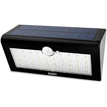 aukey clairage ext rieure lampe solaire 38 led sans fil d tecteurs de mouvement avec trois. Black Bedroom Furniture Sets. Home Design Ideas