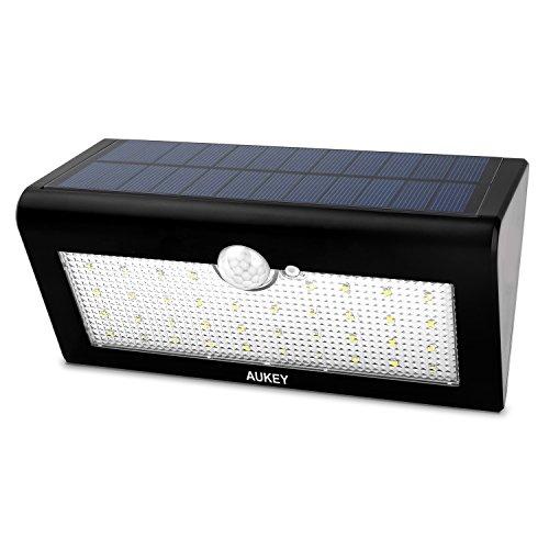 AUKEY 38 Lámpara solar con luz LED de exterior inalámbrica detectores de movimiento con tres modos de iluminación pared inteligentes de seguridad para escaleras, caminos, terraza, Patio, jardín, etc. (LT-SL1)