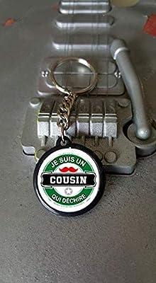Porte clés 25 mm Je suis un Cousin qui Déchire