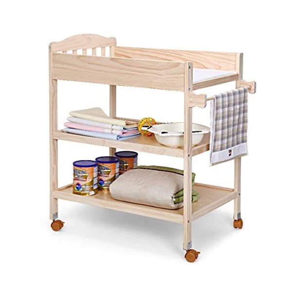 Changing Table Baby Changing Table Portable Wooden Newborn Massage Care Station Foldable Integrated Diaper Station Dresser (Color : Wood) Changing Table ●Size and Safe and Stable- 82×58×97cm/ 32×23×38 inch,Suitable for babies weighing less than 25kg,With seat belt,Changing pad has a restraining strap for added safety and is made of easy to clean, soft ●2-in-1 design- Baby changing table can be used as baby massaging table as well. It is designed at the proper height of parent to prevent mom's back aches and pains from kneeling or bending when changing diapers to babies. ●Premium materials - Using high-quality materials for our 2 in 1 infant changing table,Reinforced wood,it is durable and stable for long time daily use,And easy to clean and maintain. 1