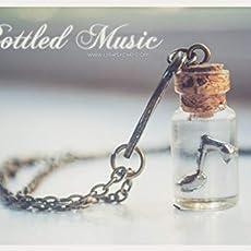 Collar de botella de música embotellado. collar de frasco de vidrio con nota.