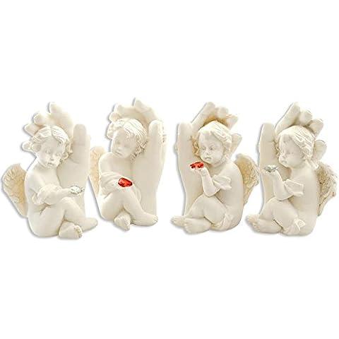 Set di 4 angeli bianchi che si