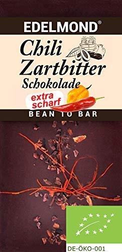 Edelmond Bio Habanero Chili Schokolade. Scharfe frische Schoten und Edel-Kakaobohnen. Hoher Kakaoanteil. Vegan und Fair-Trade, ohne Soja Emulgatoren. Scharf