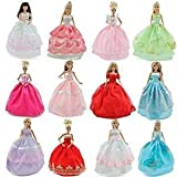 Set of 25 Barbie Sindy doll sized items (random selection) = 5x ball gown dresses, 10x shoes/boots & 10x hangers, only posted from London by Fat-catz for fast delivery