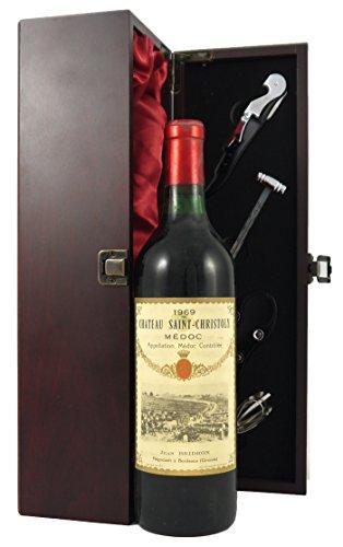 Chateau Saint Christoly 1969 Medoc Rotwein in einer mit Seide ausgestatetten Geschenkbox. Da zu vier Wein Zubehör, Korkenzieher ,Giesser ,Kapselabschneider ,Weinthermometer .