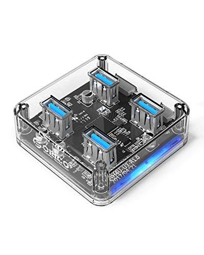 ORICO USB3.0 4 Puerto Mini Superspeed Transparente de 5Gbps-0.3M Soporte de Cable Función OTG y Puerto de alimentación Externo Reservado para MacBook iMac PC/Windows/Linux