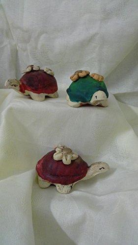tris-tortues-en-ceramique-avec-des-fleurs-en-relief