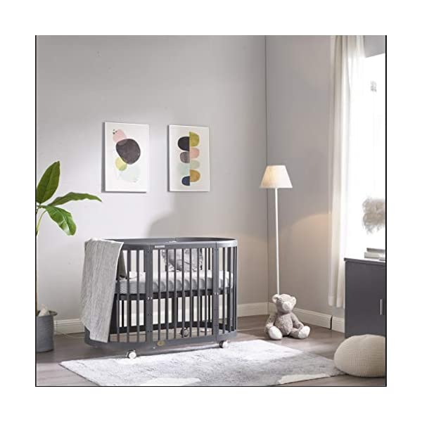 DUWEN Wooden Baby Cot European Multifunctional Small Round Bed Child Bed Convertible To 3 Positions Toddler Bed Sofa Bed Suitable For Cribs Under 6 Years (Color : Gray, Size : 123cm*68cm*76cm) DUWEN 【CONVERTIBLE CRIB】: Easy-to-change 3-in-1 cot can be easily converted from a crib to a nursing table and crib. The versatile crib will provide your child with a comfortable sleep. Beautifully designed cribs can grow with your child from infancy through childhood to adulthood. 【GROW UP WITH YOUR BABY】: The 3-bed mattress height adjustment function on the crib allows you to lower the mattress when your baby starts sitting or standing. It can keep your baby safe and comfortable in the bed that grows up with your baby. This convertible adjustable multifunctional bed will make your child's life unforgettable. 【STURDY PINE WOOD】: A crib is the perfect solution for a peaceful and worry-free sleep for parents and children. The crib is made of high-quality pine wood, which is durable and easy to deform without harming the baby. With a carrying capacity of more than 80KG, it is easy to assemble and is designed for the healthy sleep of babies aged 0-6. 1