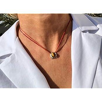 Ethnos Barcelona – Silberanhänger und Tigerauge-Halskette. Länge: 40 cm.