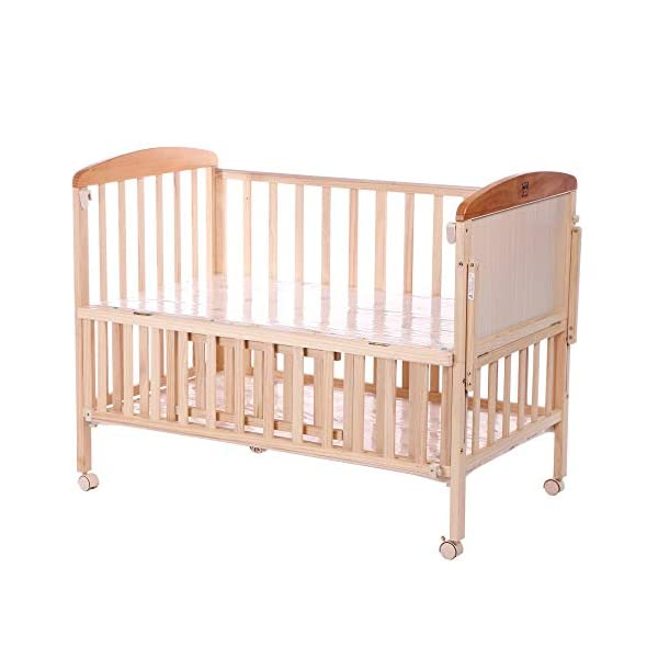 QINYUN Crib Solid Wood Without Paint Multi-functional Baby Bed Game Bed QINYUN 1. This portable crib is made of sturdy pine wood with a beautiful, non-toxic appearance, with a hard hat and locking wheel that can be converted from a crib to a baby fence with one hand. 2. Soft and encrypted mosquito net, strong and not decoupled, providing a comfortable sleeping environment for your baby The mattress attached to the cradle is gently shaken to sleep every night. 5