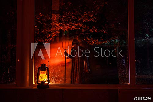 otiv: Horror Halloween Concept. Burning Old Oil lamp in Forest at Night. Night Scenery of a Nightmare Scene. #218671070 - Bild als Foto-Poster - 3:2-60 x 40 cm / 40 x 60 cm ()
