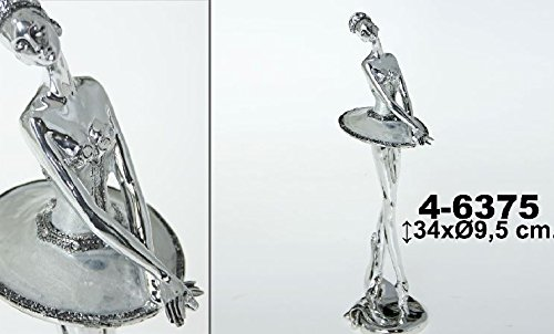 Supernova Decoracion- Standing silver resin dancer figure.Measures 34X9,5 CM