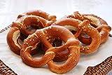 Brezel intrecciati a mano e prodotti secondo la ricetta tirolese. 150 g di bontà.