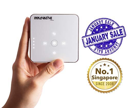 Innovative Lumiere Mini - Der kleinste Mini Beamer der Welt - LED Full HD 200 cm Bildschirm - Tragbarer Projektor mit eingebauter Batterie und Lautsprechern (Weiß & Gold)