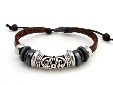 Agathe Creation , Bracelet tibetain porte bonheur , Cuir et chanvre ,  Perles metal et bois ,Perle central en argent tibetain , Marron / argent ,  Taille sur