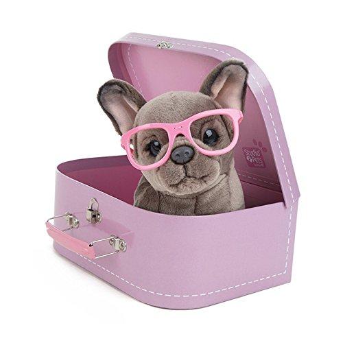 Cachorro de bulldog francés en maletín de transporte