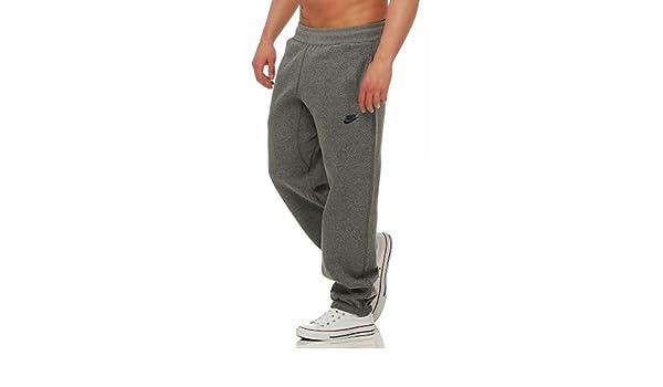 new styles f3aa7 1460d Nike Stitch Cuffed Club Sweat Pants Mens Sport Trousers Training Dark Grey  Amazon.co.uk Sports  Outdoors
