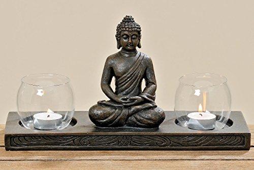 Figura de Buda en pedestal con 2portavelas de cristal