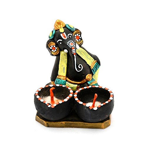ExclusiveLane Terracotta Handpainted Ganesha With Twin Diyas - Ganpati Murti Spiritual Idols, Figurine Showpiece Religious & Home Décor Religious Gift Item  available at amazon for Rs.649