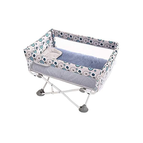 BHDYHM Lightweight Travel Cradle w/Detachable & Washable Mattress, Zippered Breathable Mesh Side,Portable Crib for Newborn Baby BHDYHM *Travel companion - or your baby to feel safe and secure even on trips, this snuggly bedside cot can be folded away within seconds by pulling the loop,therfore very light to transport *High capacity - A safe sleeping space for your baby that's larger than most standard moses baskets and bassinets. *Panels:The see through, breathable mesh panels either side, allows you to supervise your child at all times. 1