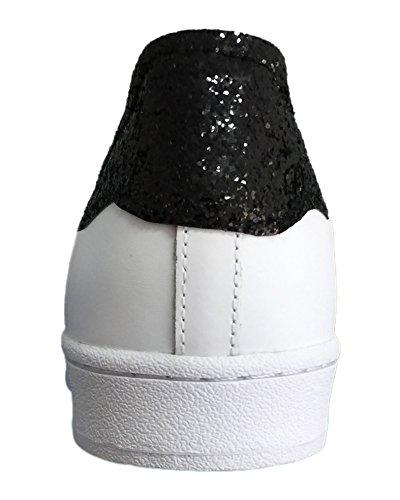 Superstar bianche con glitter nero e borchie cono basso oro Bianco