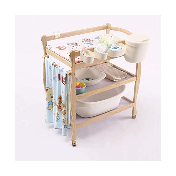 Children Changing Table with Casters Wooden, Diaper Storage Nursery Station with Pad for Newborn/Infant GUYUE Silent caster with brake. Safety rails enclose all four sides of the changing area Strong and sturdy wood construction: Pine + solid wood paint free board. 2