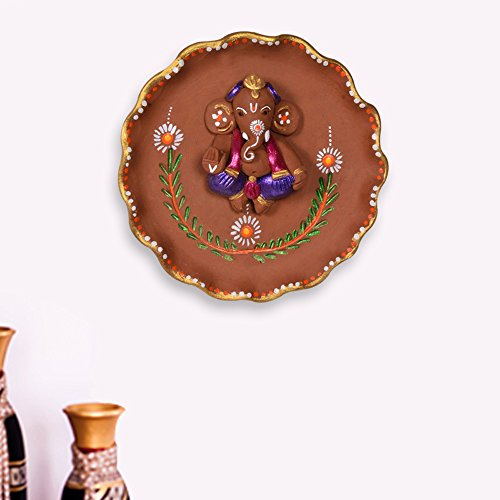 ExclusiveLane Terracotta Handpainted Round Plate Ganesha Wall Décor  available at amazon for Rs.668