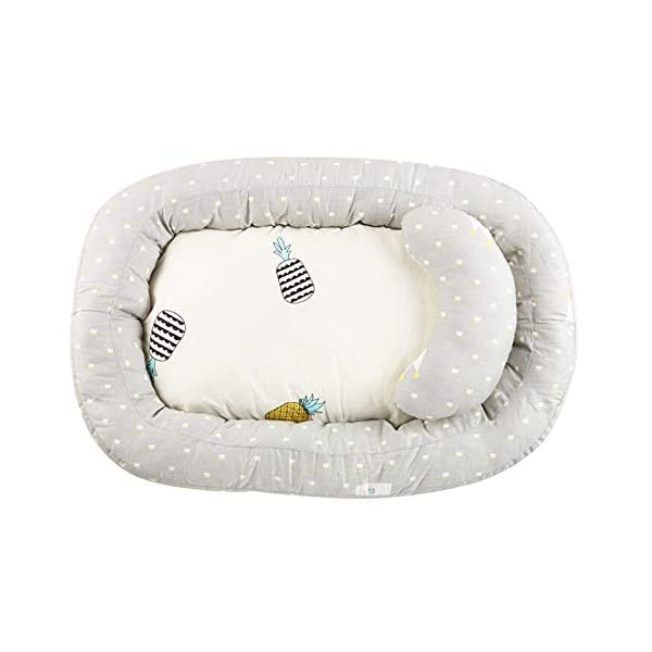Moonvvin Portable Baby Lounger Breathable Hypoallergenic Co-Sleeping Baby Cot Bed Portable Crib for Bedroom/Travel  We use 100-percent cotton fabric and breathable, hypoallergenic internal filler, which is safe for baby's sensitive skin. It will give your child serene, safe, and sound sleep in their lovely co sleeping crib. Your child will feel comfortable and safe in our soft newborn lounger. Such a secure sleeper will allow your baby to have deep and nice sleep as little ones love the imitation of a stay in the mother's womb. It helps with common newborn sleep issues like wanting to sleep in a parent's arms or frequent waking. Use the infant lounger as a bassinet for a bed, side sleeper, travel bed, newborn pillow, changing station or move it around the house for lounging or tummy time, making baby feel more secure and cozy. The lightweight design and easy-to-use package with handle make our in bed bassinet a portable baby must-have. 1