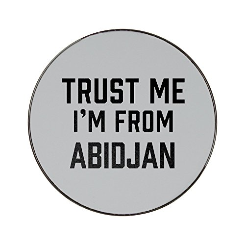 Metal round fridge magnet with Trust me I am from Abidjan