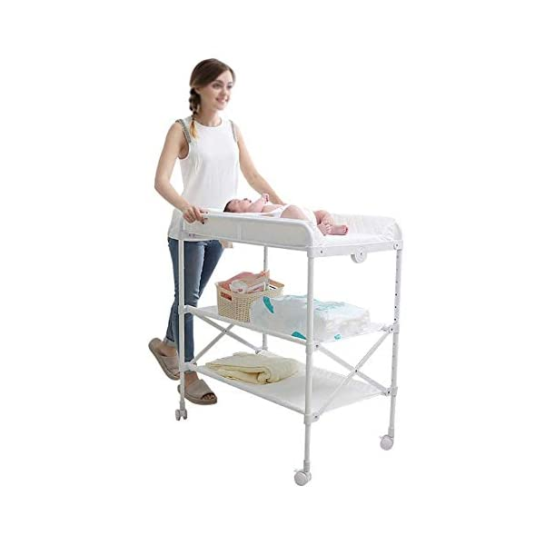 White Newborn Changing Table On Wheels, Baby Bathing Massage Baby Cot Foldable Changing Diapers Dresser with Pad GUYUE Two in one design- Baby changing table can be used as baby massaging table as well or dry your baby's small clothes, also can bathing. Iron tube paint + high quality plastic + polyester 3D mesh. Smooth mute caster. 1
