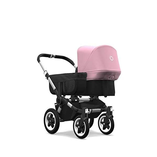 Bugaboo Donkey 2 Mono, 2 In 1 Pram and Pushchair, Extends Into Double Stroller, Black/Soft Pink Bugaboo The name donkey says it all; it's the bugaboo pushchair with the most storage space The bugaboo donkey2 mono can be easily extended to create even more space in the expandable side luggage basket & underseat basket Use extension sets to convert the bugaboo donkey2 mono into a duo or twin pushchair in just three clicks (extension sets sold separately) 2