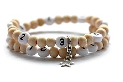 Bracelet d'allaitement avec des perles en bois de couleur neutre