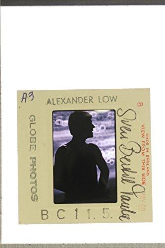 slides-photo-of-alexander-lowe-taken-his-shirt