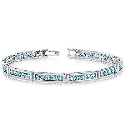 Revoni Desired Splendor: 6.00 carats total weight Round Shape London Blue Topaz Gemstone Bracelet in Sterling Silver