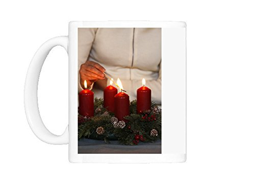 Mug-of-Woman-lighting-advent-candles-Saint-Nicolas-de-Veroce-Haute-Savoie-France-4261251