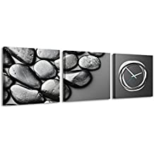 Quadrato Orologio de parete Nero pietre levigate su sfondo grigio scuro elegante foto