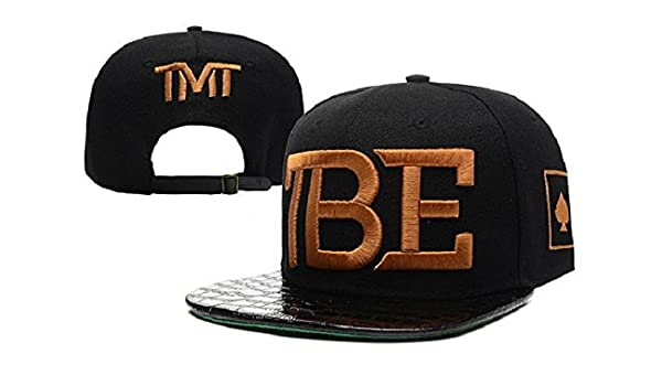 3f1a9bb35dc The Money Team TMT TBE Hysteresenhut   hats (Black.Gold Logo with leather  Brim)  Amazon.co.uk  Clothing