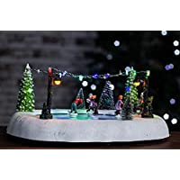 HomeZone Animated Christmas Carol Village Nativity Scene Christmas Ornament Decoration With Colour Changing LED Fairy Lights And Sounds. Battery Operated (ICE SKATING SCENE)