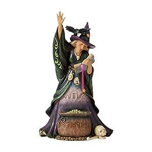 Figura de brujas con caldero,